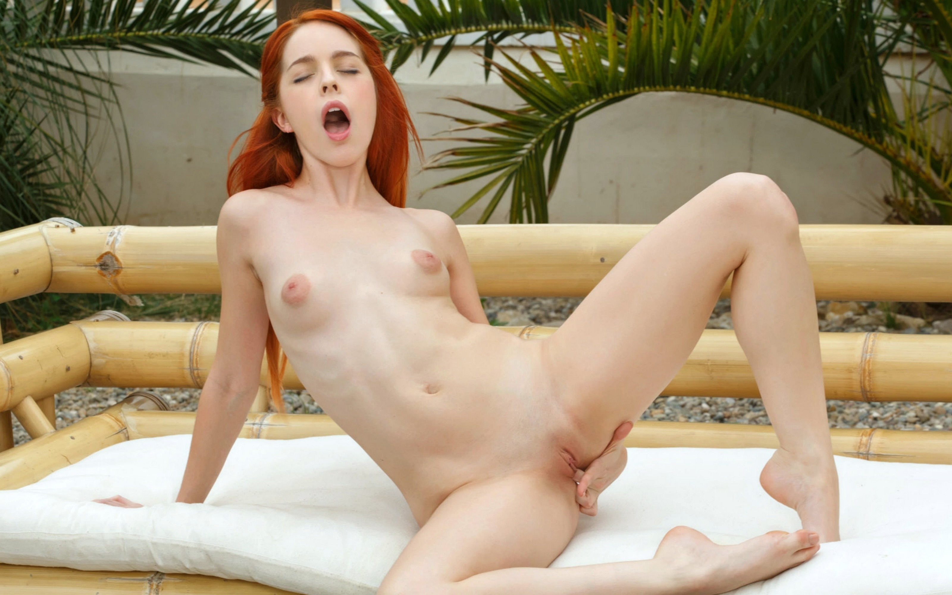 Naked redhead fingures tight pussy